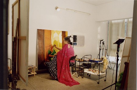 The artist in her workshop while painting